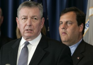 U.S. Attorney Christopher J. Christie, right, looks on as former U.S. Attorney General John Ashcroft talks at a news conference in Newark, N.J., Thursday, Sept. 27, 2007, to announce that five makers of medical device implants have reached a $310 million agreement to resolve concerns over doctor kickbacks. Authorities said the companies paid orthopedic surgeons exorbitant amounts of money to be consultants and exclusively use their products. Ashcroft will be the federal monitor of one of the companies, Zimmer Inc., based in Warsaw, Ind., which has agreed to pay $169.5 million as part of the agreement. (AP Photo/Mike Derer)
