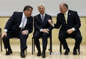 FILE In this March 5, 2014 file photograph, New Jersey Senate President Stephen M. Sweeney, D-West Deptford, N.J., right, gestures as New Jersey Gov. Chris Christie, left, talks with influential Democrat George E. Norcross III, at a groundbreaking ceremony in Camden, N.J., for the KIPP Cooper Norcross Academy school that Norcross' family foundation will help fund. As Christie potentially prepares to run for president, he has been talking a lot about how he has worked with Democrats to help turn around Camden. Under Republican Gov. Chris Christie, New Jersey has paid more than $2 billion in state tax breaks since 2014, often to corporations with notable political connections and at least one developer who already owed millions of dollars in unpaid state loans, an Associated Press review found. (AP Photo/Mel Evans,file)