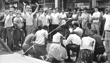 NEWS FILE/ANTHONY FALLETTA June 15, 1963 Protests in Birmingham spread to other cities including Gadsden where these demonstrators gather on a sidewalk under the taunts of whites. The protests in Gadsden were not widely reported in Birmingham. Earlier the same week Gov. George Wallace came out against Vivian Malone's enrollment at the University of Alabama.